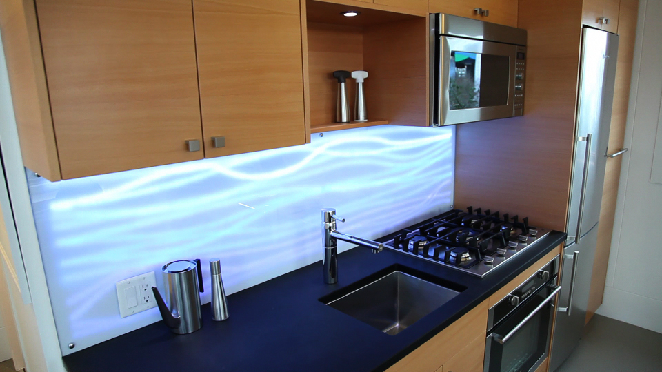 The West House kitchen backplash is an ALIS display.
